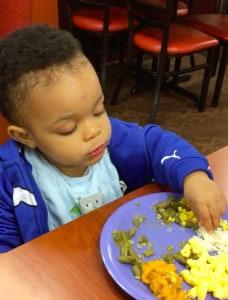toddler eating vegetables