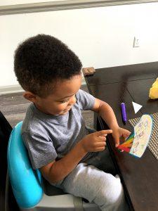 boy holding fan craft