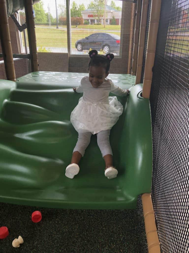toddler on Indoor slide