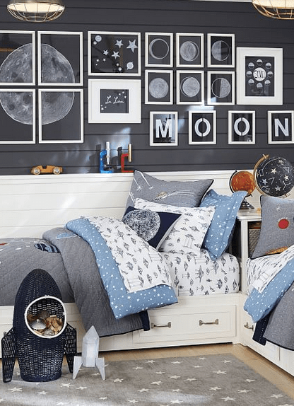 I love this rocket wicker storage basket! It adds so much to a spaced themed kids bedroom. For other great bedroom storage ideas, visit this page! #bedroomideas #kidsbedroomorganization