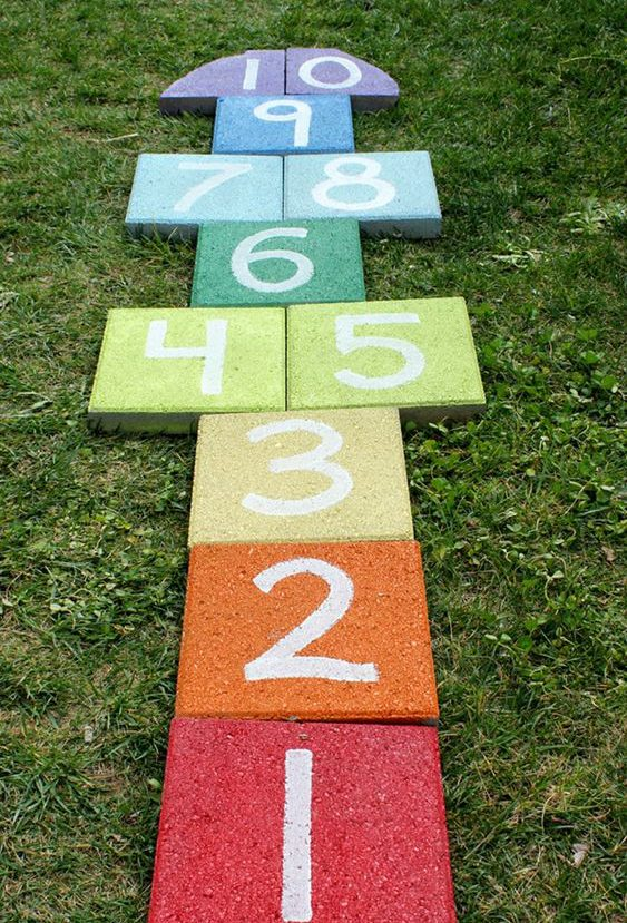 rainbow hopscoth, kid friendly backyard ideas on a budget