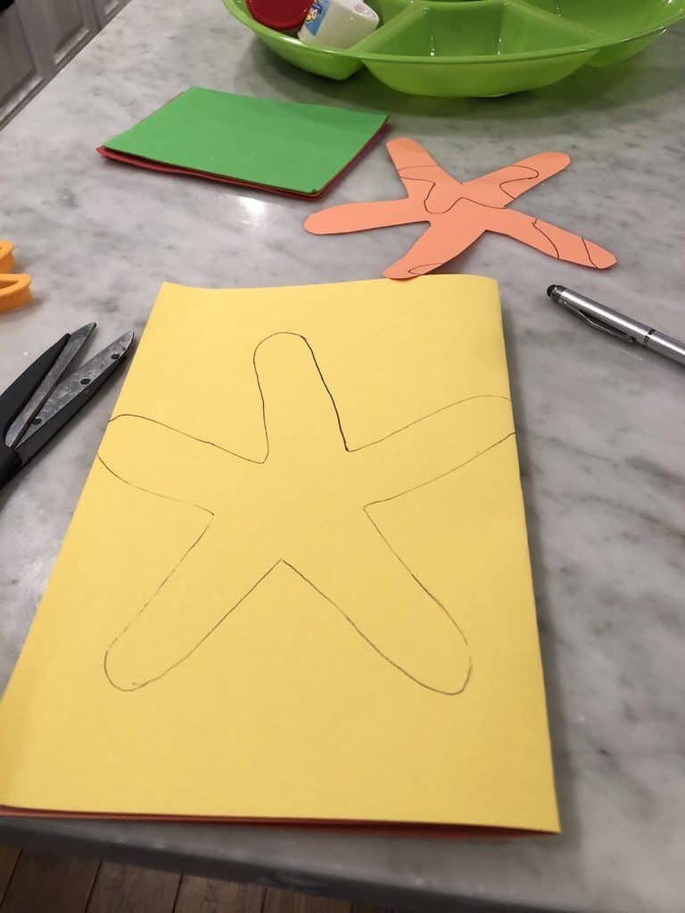 Starting Early With Toddler Fine Motor Skills Activities Is An Absolute Must! This Star Fish Decorating Craft Is A Super Easy Way To Practice Those Fine Motor Skills That Can Help With Development.