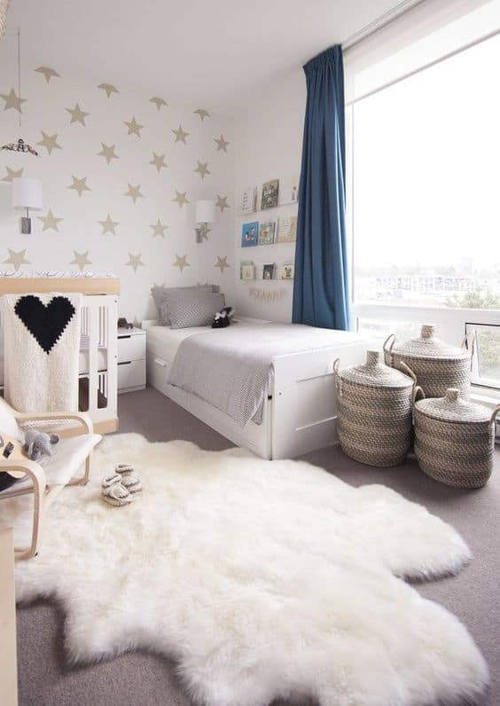 neutral-shared-room-with-a-star-print-wall-some-neutral-furniture